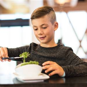 Child with salad bowl